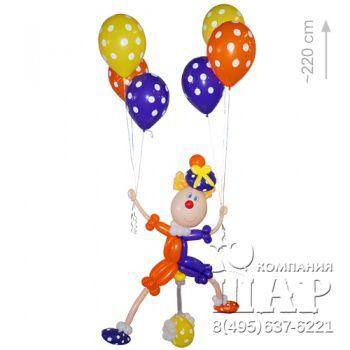 клоун из шариков на велосипеде